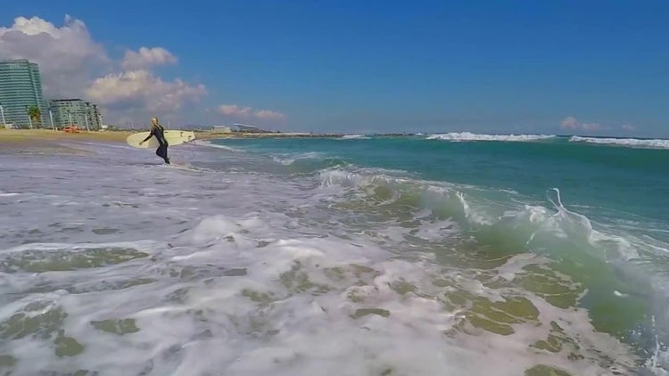 Surfer Walking Out Of Ocean: Stock Video
