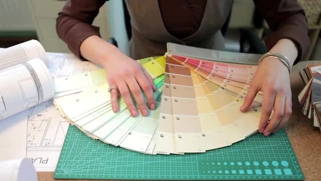 Architect Sorting Different Color Pallets: Stock Video