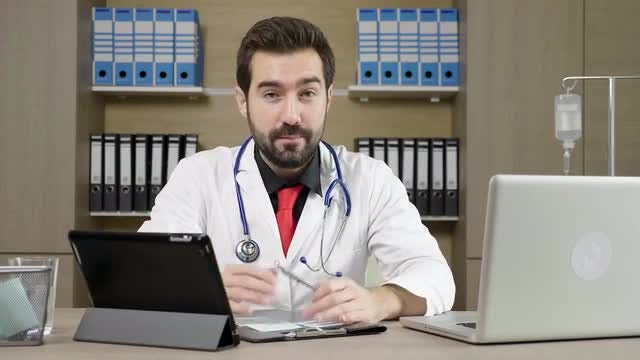 Doctor Talking In His Office: Stock Video