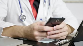 Doctor Using Smartphone In Office: Stock Video