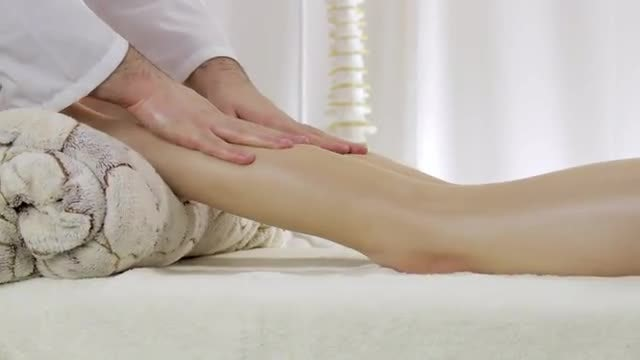 Doctor Strokes Leg Of Patient : Stock Video