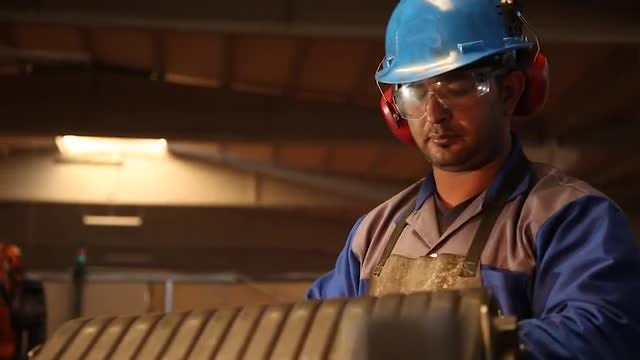 A Busy Steel Factory Worker : Stock Video