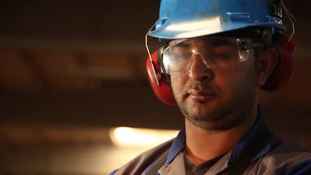 Factory Worker With Protective Gear: Stock Video