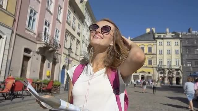 Tourist Girl Reading A Map: Stock Video