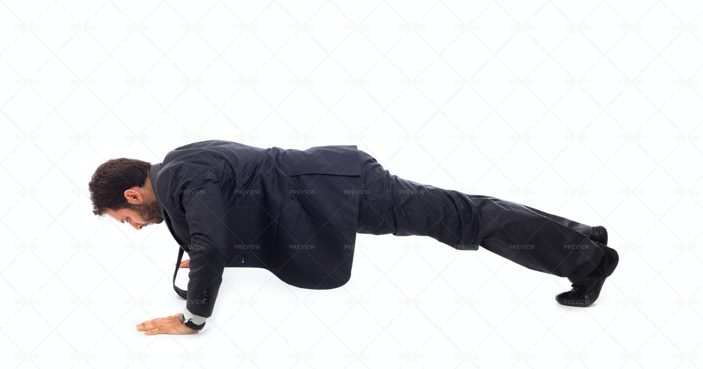 Businessman Doing Pushups: Stock Photos