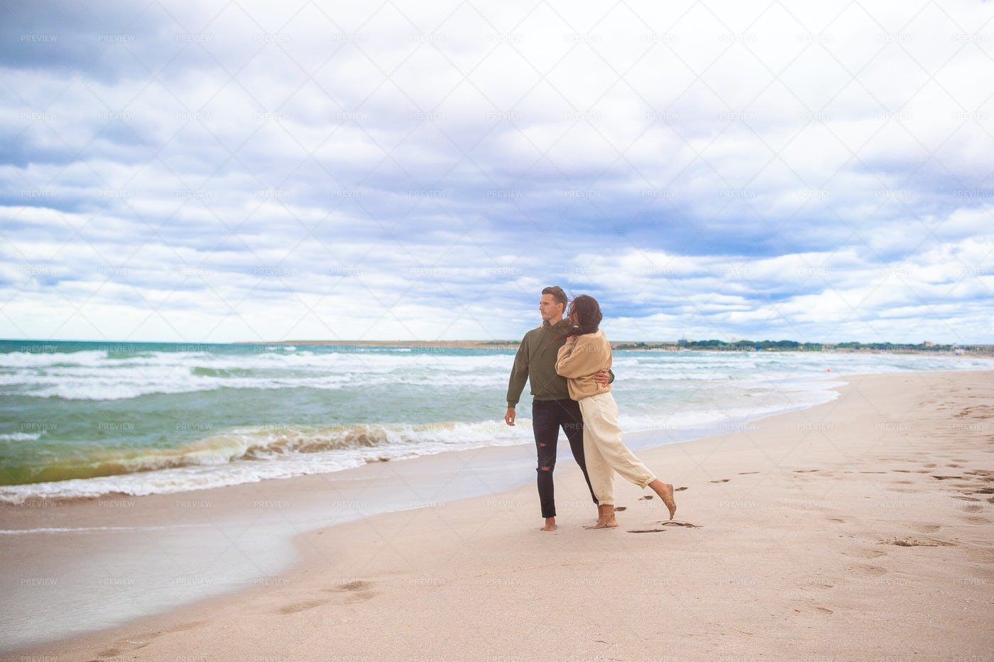 Couple On The Sand: Stock Photos