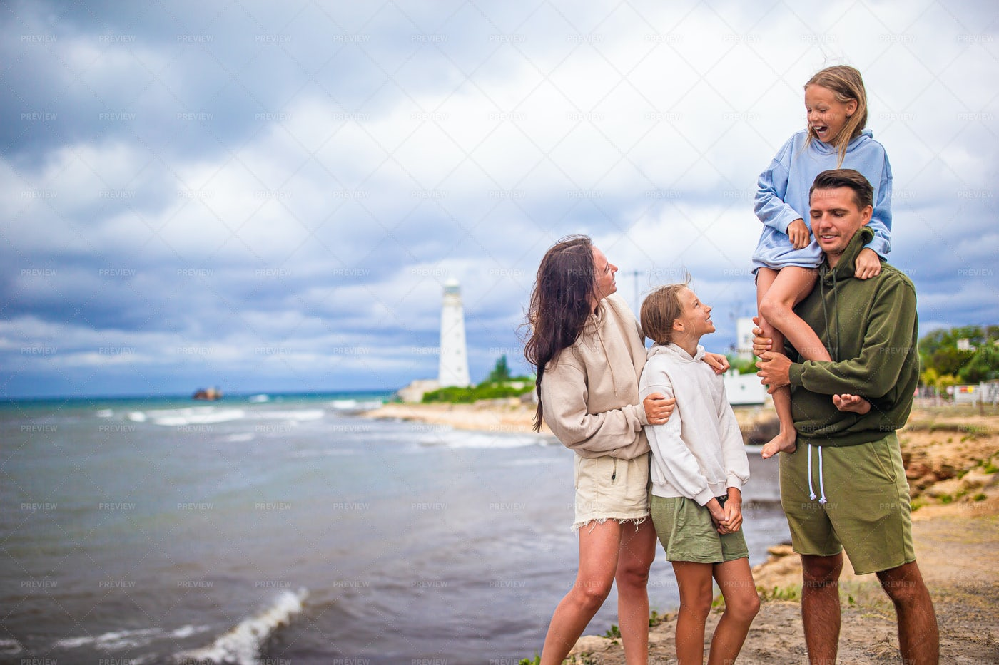 Family On Vacation At Lighthouse: Stock Photos