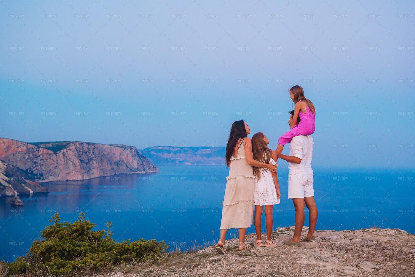 Family On The Mountain Edge: Stock Photos