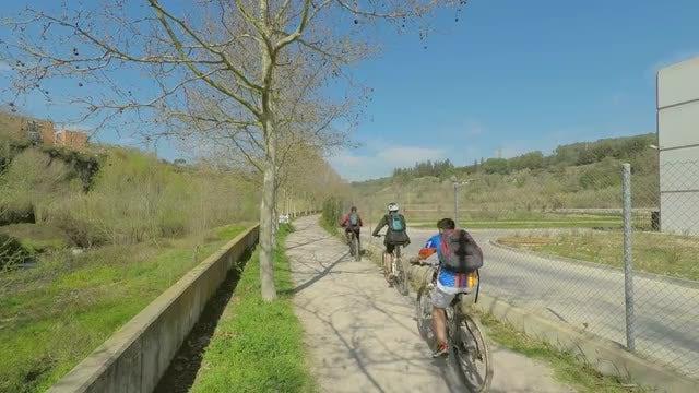 Bikers Cycling Down Sidewalk: Stock Video