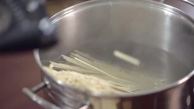 Adding Spaghetti To Hot Water: Stock Video
