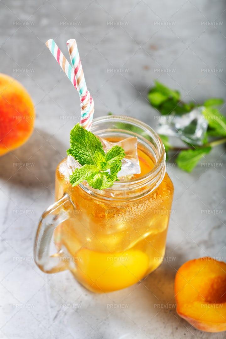 Peach Ice Tea In Mason Jar Mug: Stock Photos