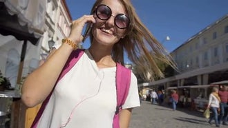 Tourist Talking On Phone Outdoors: Stock Video