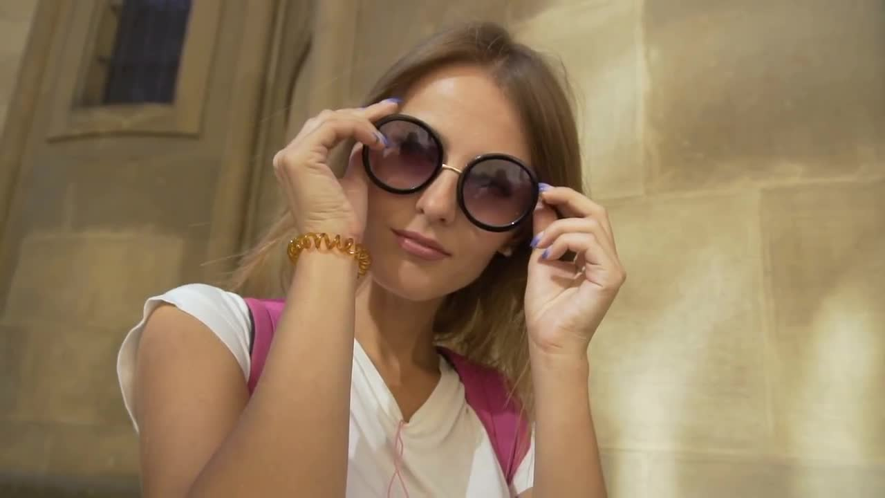 3d09d6d2a0 Pretty Girl Putting On Sunglasses - Stock Video