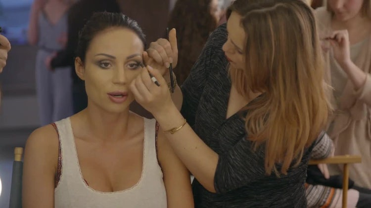Makeup Artist Glamorizing Fashion Model: Stock Video