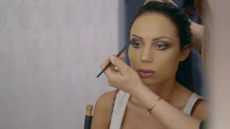 Gorgeous Fashion Model Getting Eyeliner : Stock Video