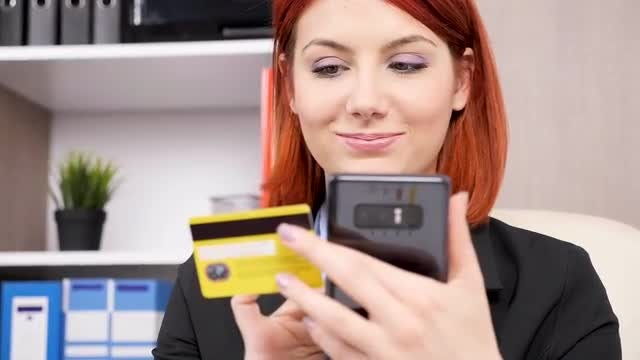 Woman Typing Credit Card Details: Stock Video