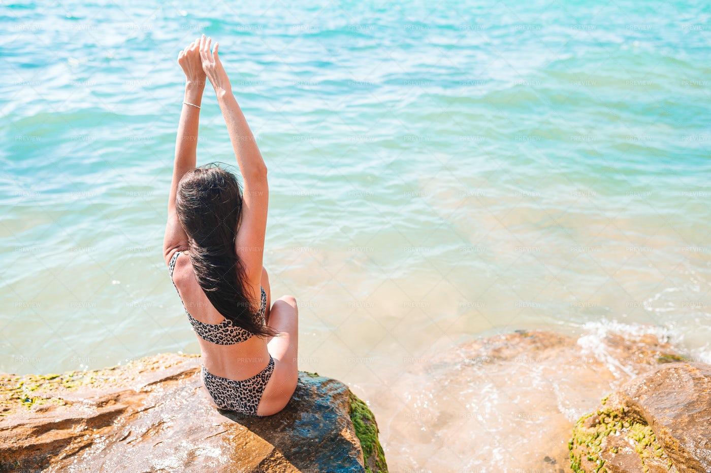 Woman On Rock Along Seashore: Stock Photos