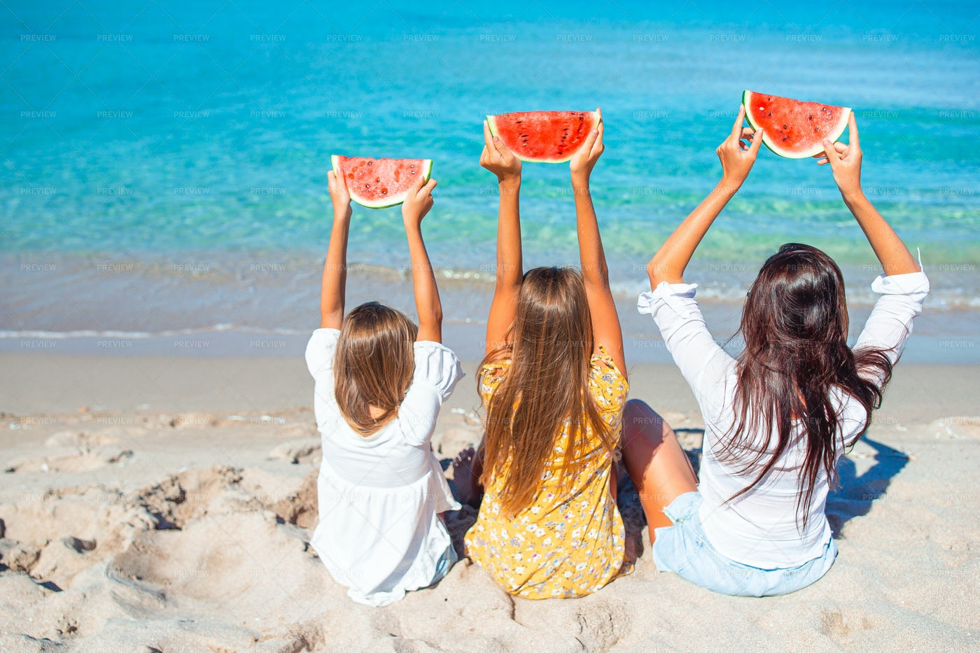 Mom And Daughters Holding Watermelon: Stock Photos
