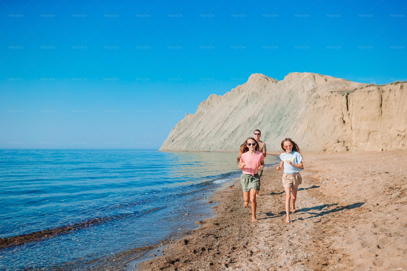 Dad And Daughters On Beach: Stock Photos