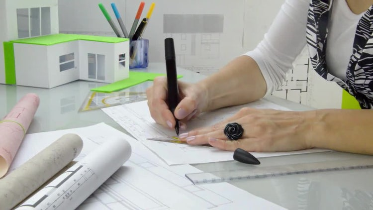 Female Architect Busy Drawing : Stock Video