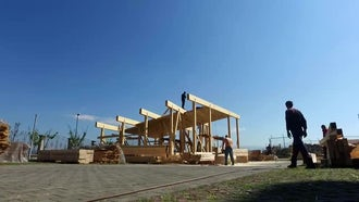 Workers At Zero-Energy Construction Site: Stock Video
