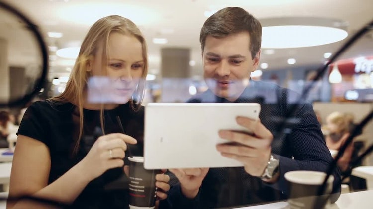 Couple Using Tablet In Restaurant: Stock Video
