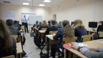 Male Teacher Teaching In Class: Stock Video