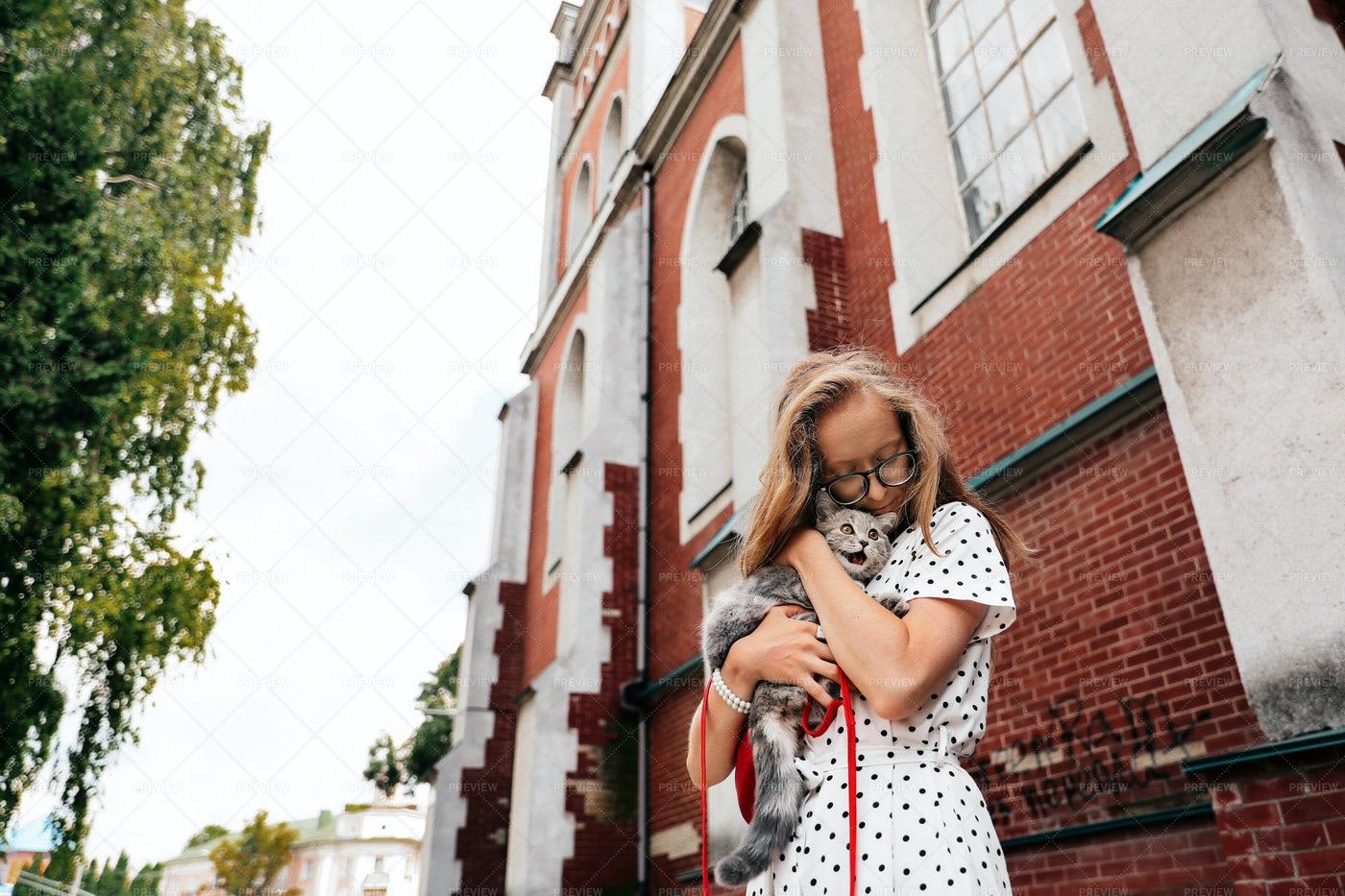 Girl Hugging A Kitten: Stock Photos