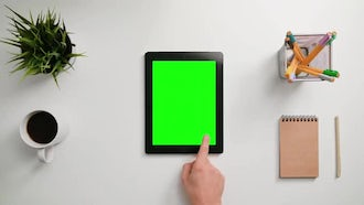Finger Scrolling On Green Touchscreen: Stock Footage