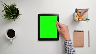 Man Scrolling On Green Tablet: Stock Footage