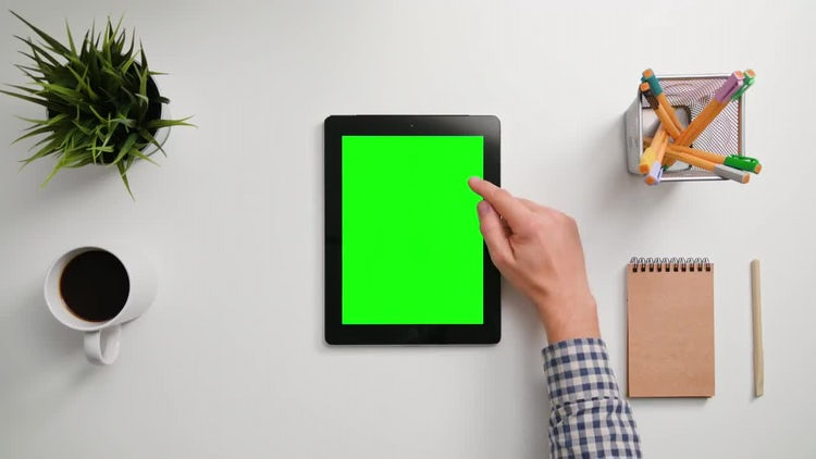 Man Scrolling On Green Tablet: Stock Video