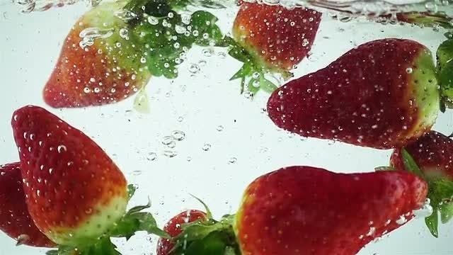 Strawberries Splashed Into Water: Stock Video