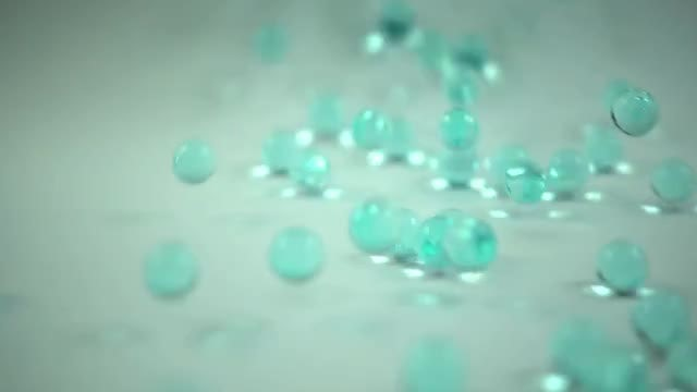 Acrylic Beads On White Surface: Stock Video