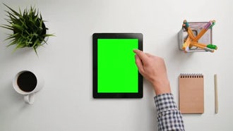 Man Using A Green Tablet: Stock Footage