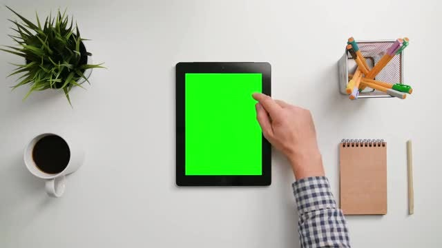 Man Using A Green Tablet: Stock Video
