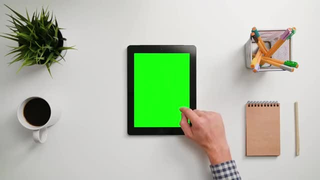 Man Scrolling On A Tablet: Stock Video