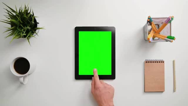 Man Tapping On A Tablet: Stock Video