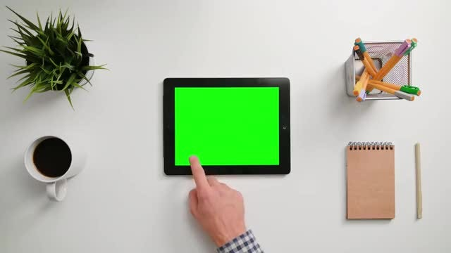 Man Scrolling On His Tablet: Stock Video