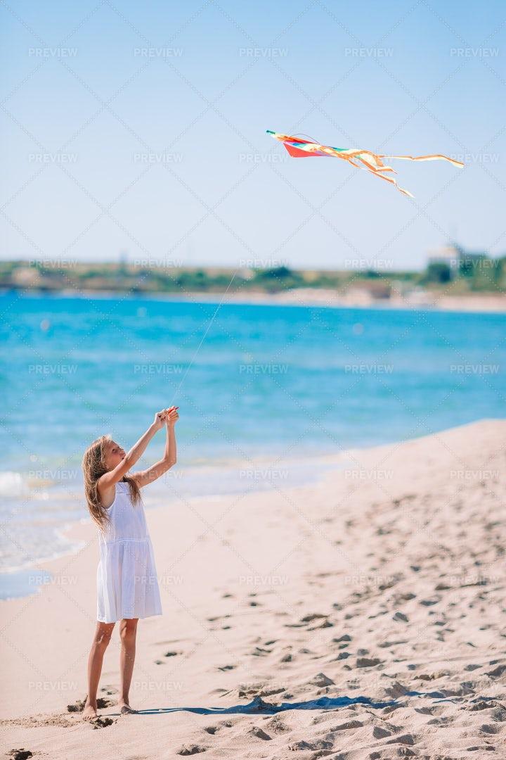 Girl Flying A Kite: Stock Photos