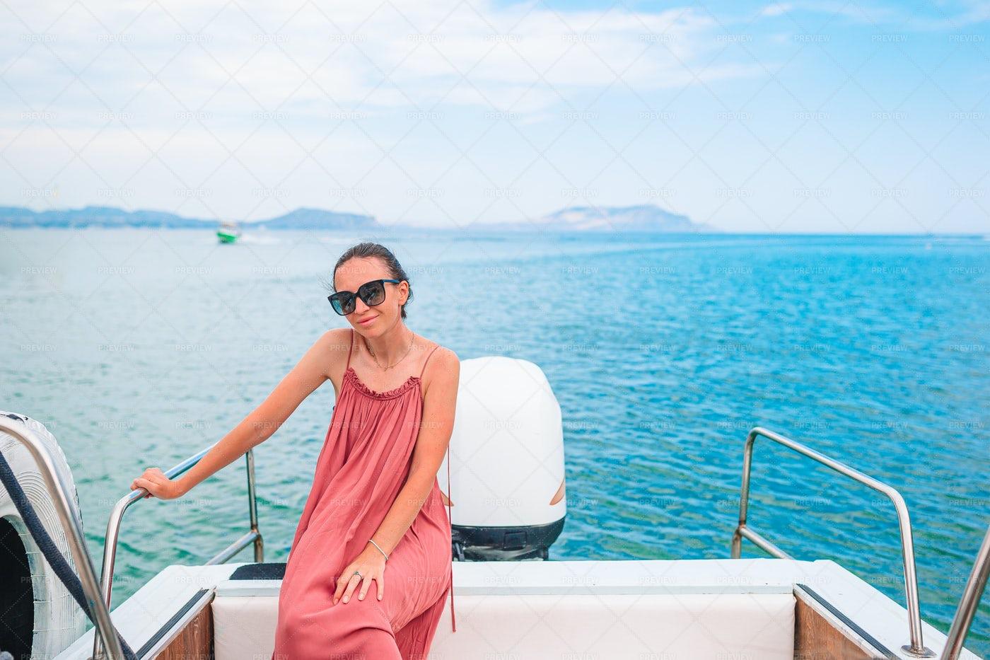 Woman Sailing On Boat: Stock Photos