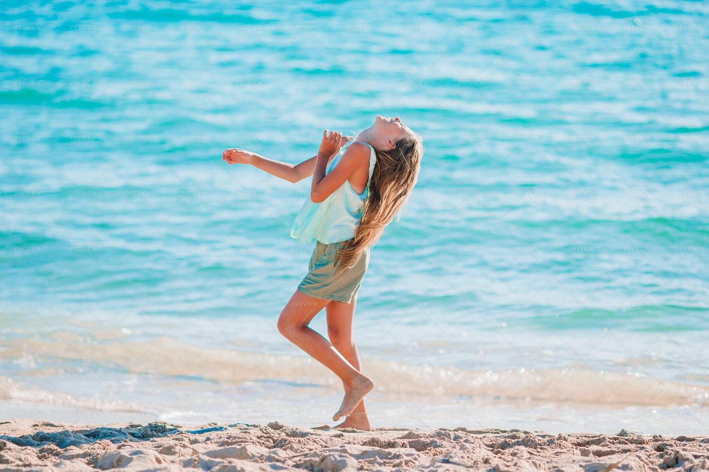 Girl Beside The Shore: Stock Photos