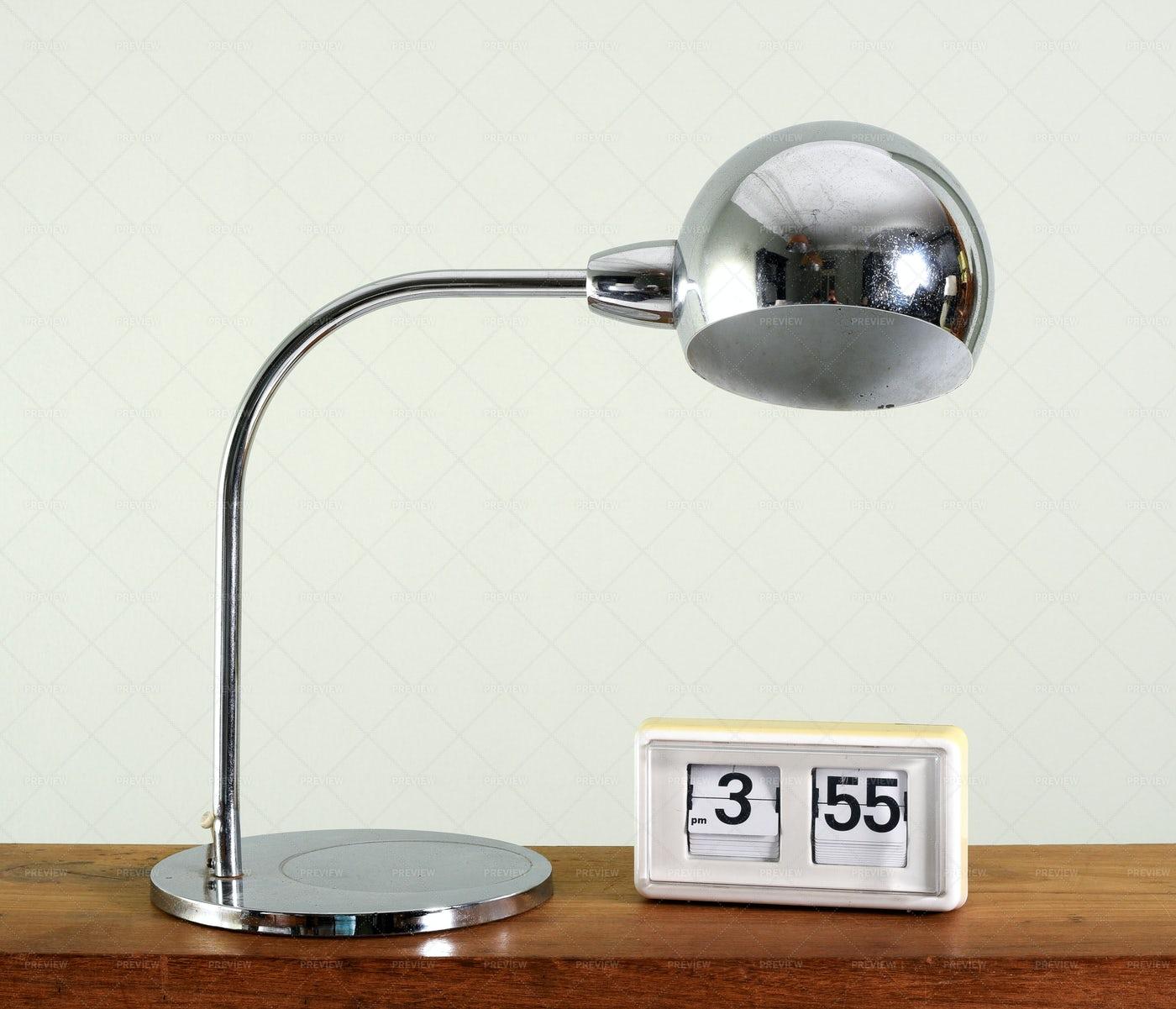 Retro Chrome Table Lamp And Flip Clock: Stock Photos