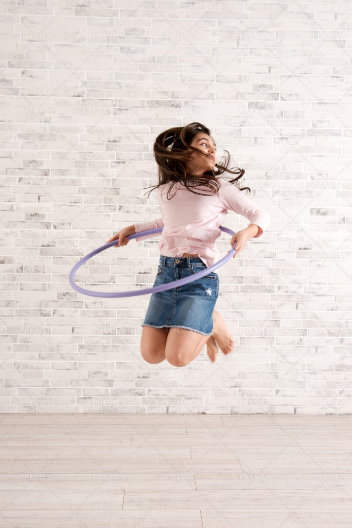 Girl Jumping With Hula Hoop: Stock Photos
