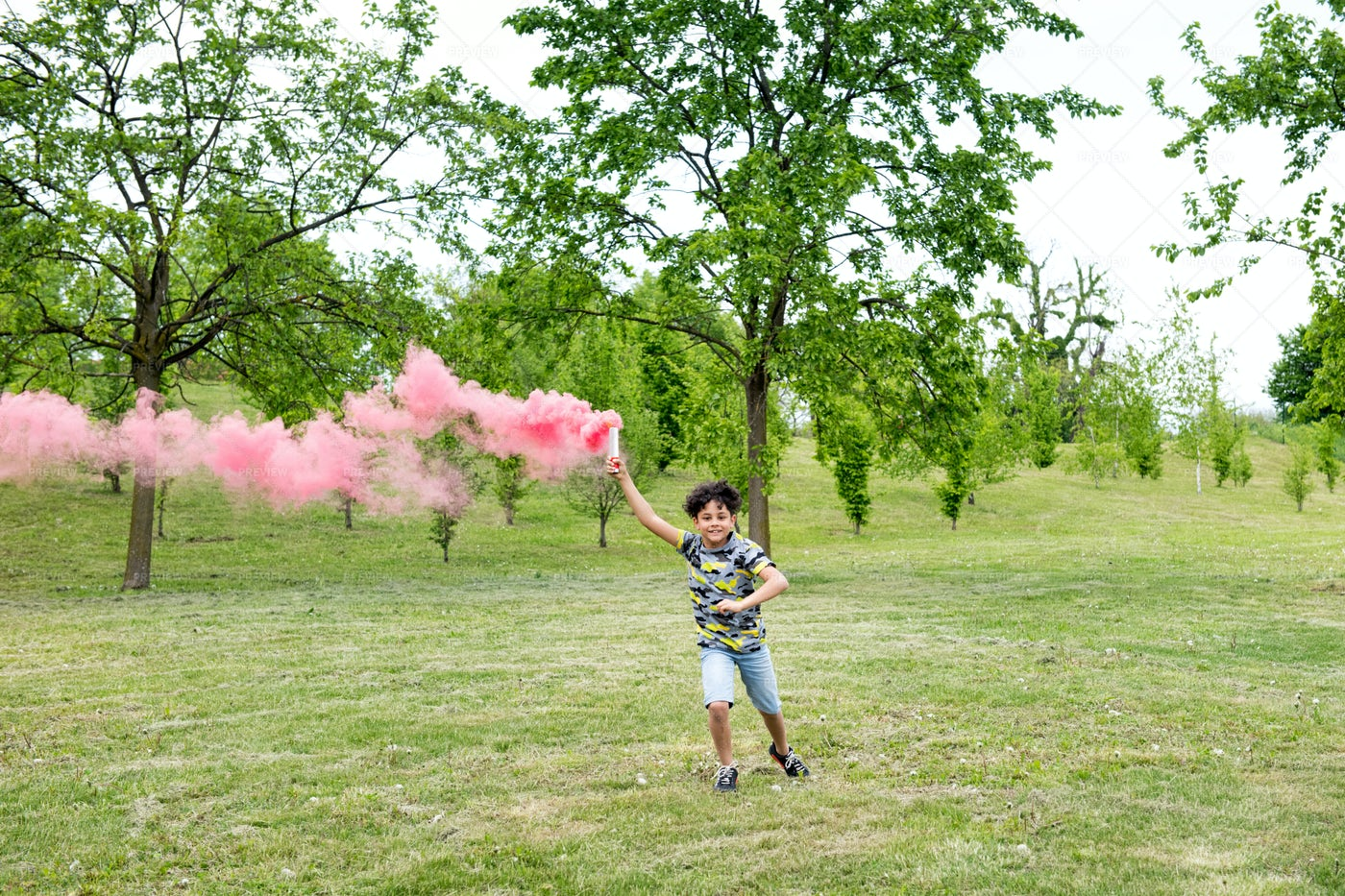 Boy Running With A Flare: Stock Photos