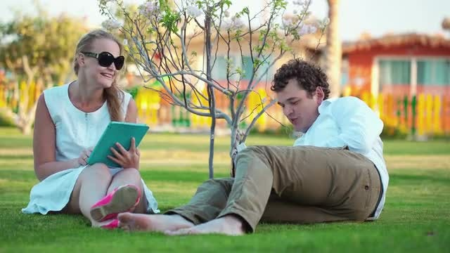 Young Couple Relaxing Outdoors: Stock Video