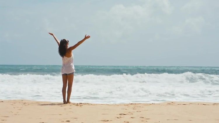 Woman lifts hands up on the sea background: Stock Video