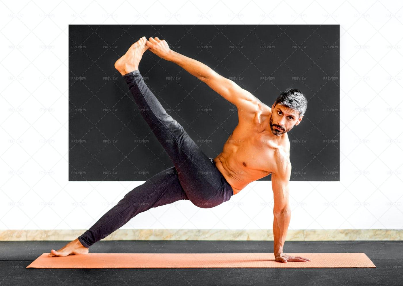 Man Doing Stretch Exercises: Stock Photos