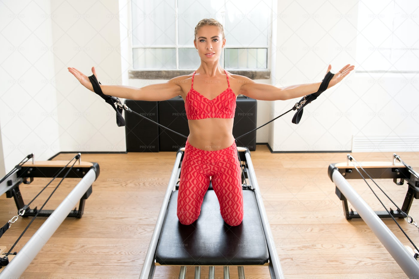 Arm Workout With Resistance Straps: Stock Photos