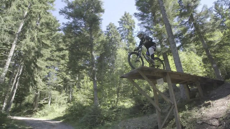 Mountain Cyclist Jumping Wooden Ramp: Stock Video