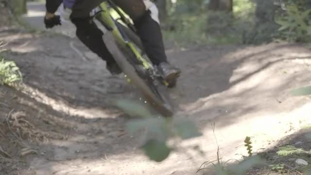 Mountain Biker Cycling In Forest: Stock Video